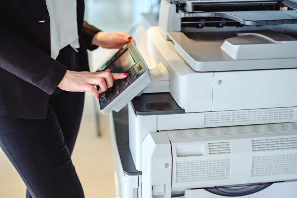woman employee scanning documents for company